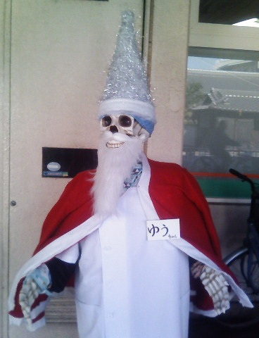 skeleton dressed up in a santa claus outfit